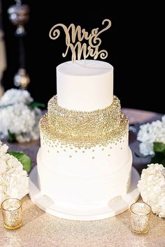 Gold confetti wedding cake with fun Mr and Mrs cake topper
