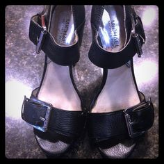 Michael Kors heels Black leather with Michael Kors logo on buckles. A little wear on end of toes see picture. Missing one heel cap, but not noticeable. Michael Kors Shoes Heels
