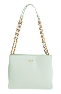 A trio of spacious compartments make this structured Kate Spade bag so convenient and chic.
