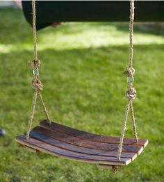 """Barrel Stave Swing - VivaTerra - After aging premium wines, authentic American and French oak wine barrels get a whimsical make-over. Four staves become a unique suspended seat. Kick off your shoes and swing awhile. Base ropes included, but hanging ropes are not. 23""""L x 13.5""""W - $149"""