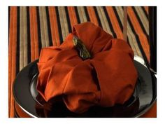 How to fold a pumpkin napkin for your collection of napkin folding projects! teehee