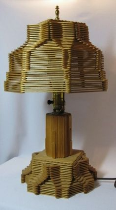 another Popsicle stick lamp  http://www.etsy.com/listing/43561509/popsicle-stick-lamp?utm_source=OpenGraph_medium=PageTools_campaign=Share