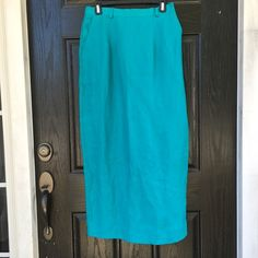Teal linen skirt with slit NWT! Gorgeous and vibrant teal blue maxi skirt with a slit in the back. Elastic waistband on the sides. Zips up and buttons in the back. Fully lined. 100% linen. Two front pockets!! The length is 38 inches. The waist measures 14 inches across, but it can stretch to 15 inches. The tag says size 10 but fits smaller in my opinion. Thanks for looking.💕 Sharon Young Skirts Maxi