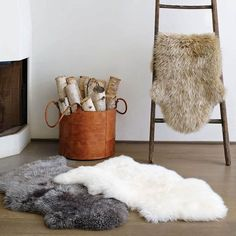 Sheepskin Area Rug: This versatile design element makes a dramatic statement in any room. Made with premium sheepskin, this rug offers natural beauty and tactile appeal that may make you want to forgo your furniture for the floor. Chic Living Room, Home And Living, Sheepskin Throw, Australian Interior Design, Modern Loft, Home Collections, Ladder Decor, Uggs, Area Rugs