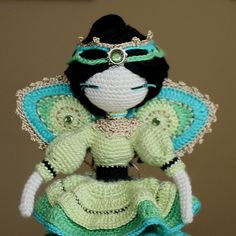 "Ravelry: Galileodesigns' Little Angel of Healing.  I used Cat Lady pattern for the body.  Highly modified the clothing and made extras.  Wings are a modified version of Crochet Peacock Feather ""Java"" Motif (on etsy).  Modified ""Bad Hair Day Headband"" available free on Ravelry."