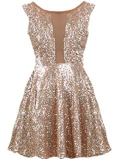 New Year's Kiss Dress: Features a cleverly designed bodice with taupe mesh paneling to the front and upper back, glittering ash gold sequin foundation, figure flattering empire waist, and a twirl-worthy A-line skirt with to finish. by Katellerts Pretty Dresses, Beautiful Dresses, Prom Dresses, Formal Dresses, Skater Dresses, Sparkly Dresses, Dress Prom, Nye Dress, New Years Dress