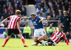 Danny Graham goes to ground to battle Everton's Phil Jagielka today