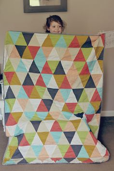 d. A triangle quilt it was! They are quite the rage at the moment :) We discussed colors, to use batting or not, and size. She decided on the above colors with a stripey binding; no batting (since she lives in Florida which is a rather warm state); big enough to cover the crib mattress for when it transitions into a toddler bed.