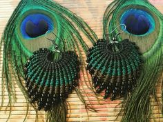 Hey, I found this really awesome Etsy listing at https://www.etsy.com/listing/610498249/peacock-feather-macrame-earrings-green