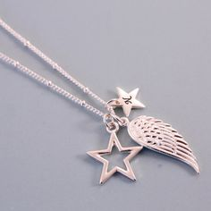 An on trend angel wing charm necklace. Made with unique silver colour charms. This necklace includes our unique angel wing charm with infinity
