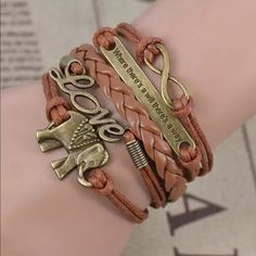 Leather brown bracelet Leather very cute elephant with where there's a will theres a way and love symbol ...sale one for 7$ or 2 for 10$ ... Fashion jewelry Jewelry Bracelets