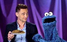 Tom Hiddleston...with a plate of cookies...and Cookie Monster.  What a perfect pairing.