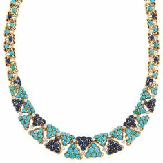 Gold, Turquoise, Lapis and Diamond Necklace, Cartier. photo Doyles New York 18 kt., the openwork tapering necklace composed of interlocking triangle-shaped clusters of round cabochon turquoise spaced by clusters of round cabochon lapis, all edged by scalloped gold borders, tipped by 21 round diamonds approximately 1.90 cts., signed Cartier Inc., Made in France, no. 31064,