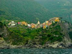 ~ Corniglia, Cinque Terre ~ Travel to Italy on a Rick Steves Heart of Italy in 9 Days Tour: https://www.ricksteves.com/tours/italy/heart-italy. On Day 6, you can choose to hike the famous cliff-side paths between Cinque Terre villages — or pick a village where you can explore the stairways and alleyways, sun yourself on the rocks, and sip on cappuccino or vino at an outdoor café. (Photo: Doug Croft)