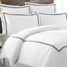 Refresh your master suite or guest room with this cozy 3-piece duvet set, showcasing an accent border in black. $49   Product: ...
