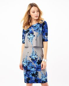 Phase Eight Lauren Tiered Dress A double layer jersey dress with a  placement floral print. The dress features short sleeves, a round neck and  a full lining.