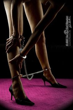 Handcuffs. Leg cuffs. Chains.