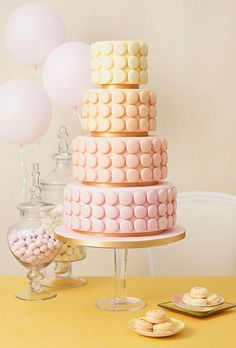 Brides.com: . Pastel Macaron Wedding Cake. In Manhattan, we're lucky to have an outpost of Paris's famed patisserie Ladurée, which means I have easy access to my favorite French macaron cookies. Here, pastry chef Zoe Clark of The Cake Parlour, in London, baked dozens of macarons in soft, sunset shades and used the cookies to decorate matching fondant-covered tiers. The result is warm and romantic, and the lucky guests get not only a slice of cake, but a sweet macaron treat, too!   Browse ...