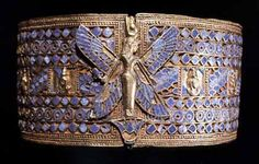 Gold armlet with colored glass inlays that belonged to Queen Amanishakheto. This and the rest of the queen's jewels were found in 1833, reportedly in a chamber near the top of her pyramid.  Courtesy of the Egyptian Museum, Berlin.