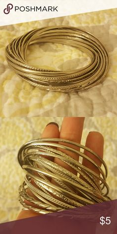 20 Bangle Set 20 interlocking bangles! Different designs shown best in second photo. Not real silver. Jewelry Bracelets