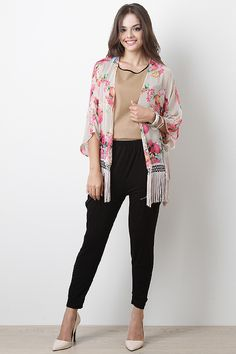 Give your style a feminine twist with the Bohemian Garden Cardigan. This cardigan features semi-sheer chiffon with floral print throughout, open front, short kimono sleeves, tassel fringe hem, and finished with stitching accents.