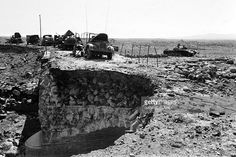A Syrian military convoy destroyed by the Israeli army is abandoned near a bridge on the Golan Heights, in October 1973 two weeks after the beginning of the Yom Kippur War. On October 06, 1973, on the Jewish holiday Yom Kippur, a two-pronged assault on Israel was launched: Egyptian forces stuck eastward across the Suez Canal and pushed Israelis back, while Syrians advanced from the north and had broken through the Israeli lines on the Golan Heights.