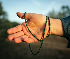 Patience combines Malachite and gold to bring the wearer to the present moment, allowing them to release things that block feelings of patience and calm