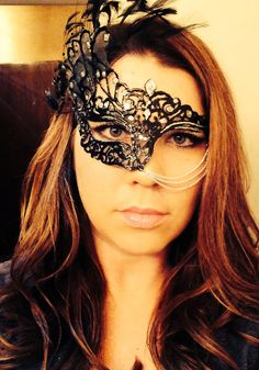 DIY masquerade mask- I like how she used chains... would probably do pearls, though :)!