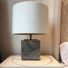 New to our signature collection this is an elegant marble table lamp with bronzed detailing. The structure of the lamp is made from black marble with a bronzed plinth on the top and bottom of the lamp. Also available in white or black marble