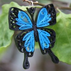 Beautiful blue emperor butterfly pendant.  Handcrafted by the art of paper quilling.  Original pattern by Honey's Hive