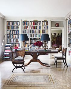 White bookshelves with traditional furniture. Beautiful table.