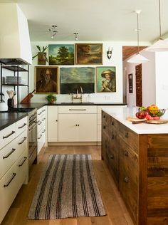 That 70′s Kitchen: From Drab to Fab -- Add An Island: This may sound counterintuitive, since you're adding a block of furniture to your kitchen, not removing something. But, coupled with the open shelves, an island is a wonderful way to give the illusion of a bigger kitchen because there will be more counter space.