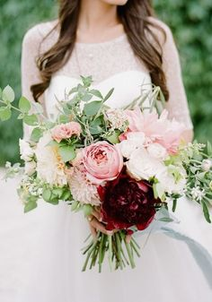 Give your peony bouquet a modern, autumnal, rich twist by adding marsala or burgundy red accent blooms and trailing greenery in a hand-tied arrangement of flowers? STUNNING! 15 Of The Prettiest Pink Peonies For Your Wedding • Wedding Ideas magazine