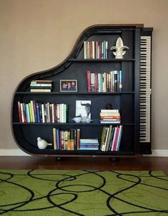 22 Creative Bookshelves Guaranteed to Give You Shelf Envy This creative bookshelf, shaped like a piano, would be a great addition to any home library. Unique Furniture, Diy Furniture, Furniture Design, Music Furniture, Modular Furniture, Furniture Showroom, Furniture Dolly, Urban Furniture, Refurbished Furniture