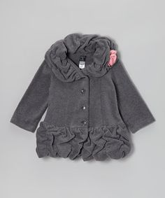 As timeless as it is time-saving, this stylish coat is made from warm, washable fleece with a dainty rosette accent, ruched drop-waist silhouette and elegantly ruffled collar.