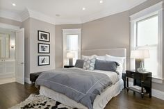 Brey and Beige Bedroom:  Benjamin Moore - Grege Avenue - greige walls light gray headboard blue purple duvet shams glossy espresso stained wood elegant nightstands black white cowhide rug crown molding