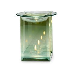 """Reflective surfaces on front and back panels create multiple points of light from burning tealight, sold separately. Glass dish holds Scent Plus® Melts, or Scented Oil sold separately. 5"""" h, 4"""" w."""
