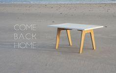 Come Back Home is a minimalist table design that features 2 contrast elements: natural oak feet and white gloss table top.
