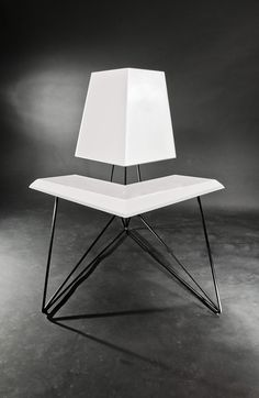 AirChair by Federico Mauro Costa - Inspired by the framework of the the very first experimental aircraft, the Air Chair's triangular steel structure is at once reminiscent of flyers of the past and modernly minimal. | Yanko Design