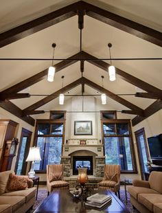 Great Room traditional living room. Watch the fire from inside or outside.  Aneka Interiors