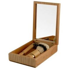 personalized shaving kit, complete with a shave brush, razor and four additional refills all housed in a handsome maple box with mirror. $64.95
