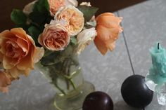 plums with orange/yellow garden roses