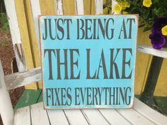 This hand painted, wooden KerriArt box sign measures 12 by12 inches and is light weight and easy to hang and ready to ship. It is painted turquoise and heavily sanded with brown/black letters Rubbed with my aging medium, it has an old time worn appearance.