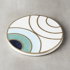Shop Canary Round Marble Trivet.   Designed by Molly Fitzpatrick and inspired by old leaded glass windows.  Concentric circles overlap to create an active pattern with moments of calm.