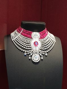 The Reine Makéda Necklace - in platinum set with a 15.29-carat oval-shaped ruby from Mozambique, a 3.51-carat D IF rose-cut diamond, a 5.10-carat pear-shaped rose-cut diamond, cabochon-cut and faceted ruby beads, pear-shaped rose-cut diamonds, calibré-cut diamonds, and brilliant-cut diamonds