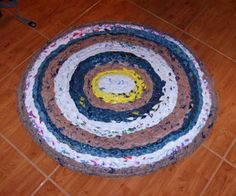 How to Make a Rug from Plastic Grocery Bags - this is braided and then kind of ironed to fuse together - read the comments too - - someone mentioned spraying some kind of flexible paint