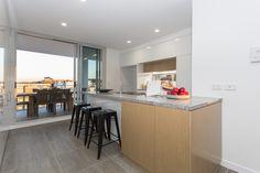 Kitchen area and balcony - DoubleOne 3 Apartments by Devine | Teneriffe, QLD Australia #devine #apartment #property #investment #brisbane #australia