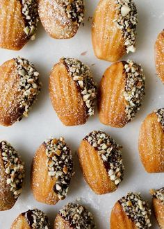 Dark Chocolate Ganache and Pecan Dipped Brown Butter Bourbon Madeleines recipe by Kate Wood Pecan Recipes, Sweet Recipes, Cookie Recipes, Köstliche Desserts, Delicious Desserts, Dessert Recipes, French Cookies, Le Diner, Brown Butter