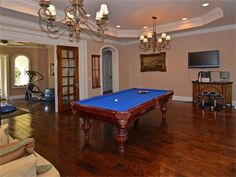 Set up the perfect shot at the #pooltabel in this lavish game room. The finest materials and detail are apparent everywhere in this spectacular 8 bedroom estate, including a majestic handcrafted stone fireplace from the 1800's, transported from a French chateau in Normandy. Magnificent grounds offer swimming pool, expansive marble patio with fountains and tropical landscape. http://www.npsir.com/eng/sales/detail/224-l-729-4458035/8392-twin-lake-dr-boca-raton-fl-33496-boca-raton-fl-33496…