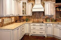 Custom Woodworking   Marsh Kitchens granite counter tops, white cabinets, wood paneling, traditional style, under cabinet lighting